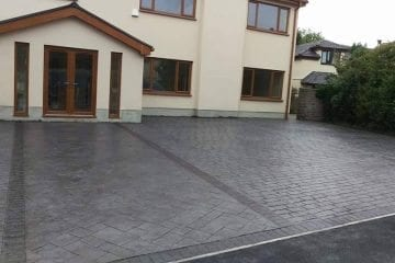 imprinted concrete driveway on house